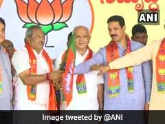 कर्नाटक के अयोग्य विधायकों में से 15 भाजपा में हुए शामिल, रोशन बेग पर अभी फैसला नहीं