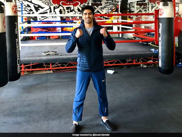 Vijender Singh Beats Former Commonwealth Champion Charles Adamu To Claim 12th Successive Win