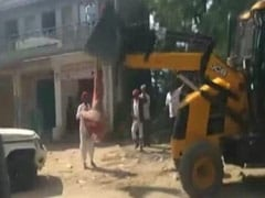 Watch: Village Head Climbs On JCB Machine To Stop Alleged Encroachment
