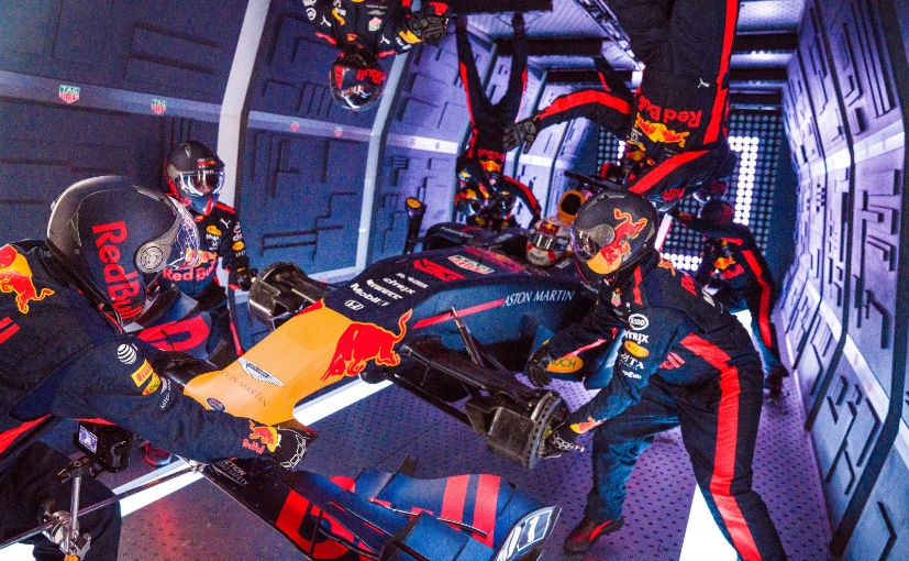 The sequence was shot with a 16 member pit crew and filmed over a course of a week