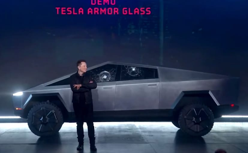 Tesla CEO Elon Musk with the newly unveiled Cybertruck after the incident