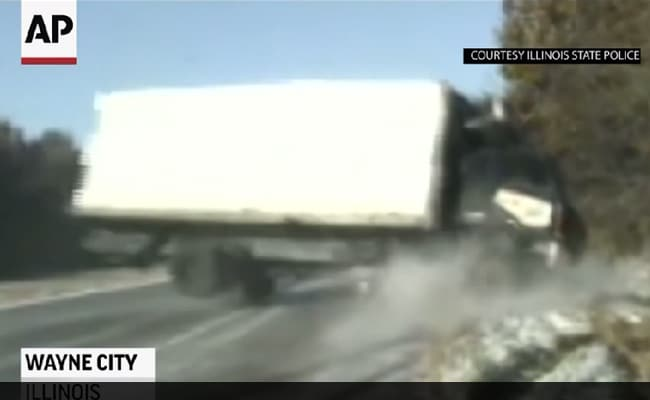 On Camera: Narrow Escape For 3 As Out Of Control Truck Crashes On Icy Road