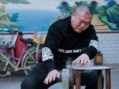Beer-Drinking, Brick-Breaking Chinese Villager Becomes Twitter Sensation