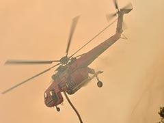 Sky-High Smoke Dwarfs Waterbomber Helicopter In Australia