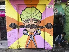 டெல்லி குடிசைப் பகுதியை வண்ணமயமாக்கிய கலைஞர்கள் : கலக்கல் புகைப்படங்கள்