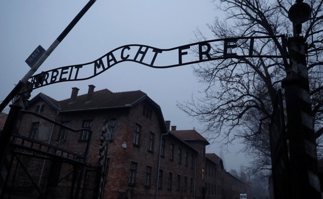 German chancellor Angela Merkel makes first visit to Auschwitz