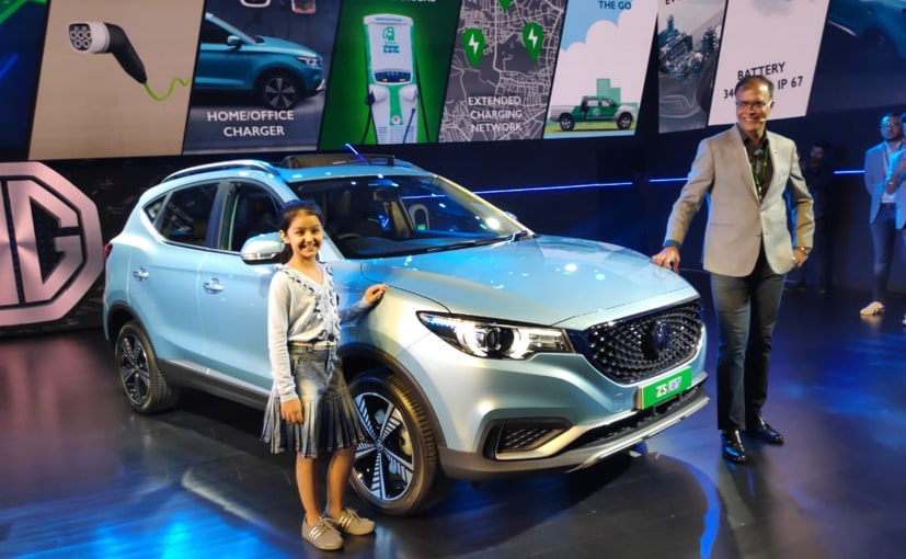 Rajeev Chaba, President & MD, MG Motor India and actor Prachi Thakur with the MG ZS EV