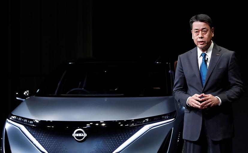 Nissan Motor's chief executive Makoto Uchida speaks next to the Ariya Concept car