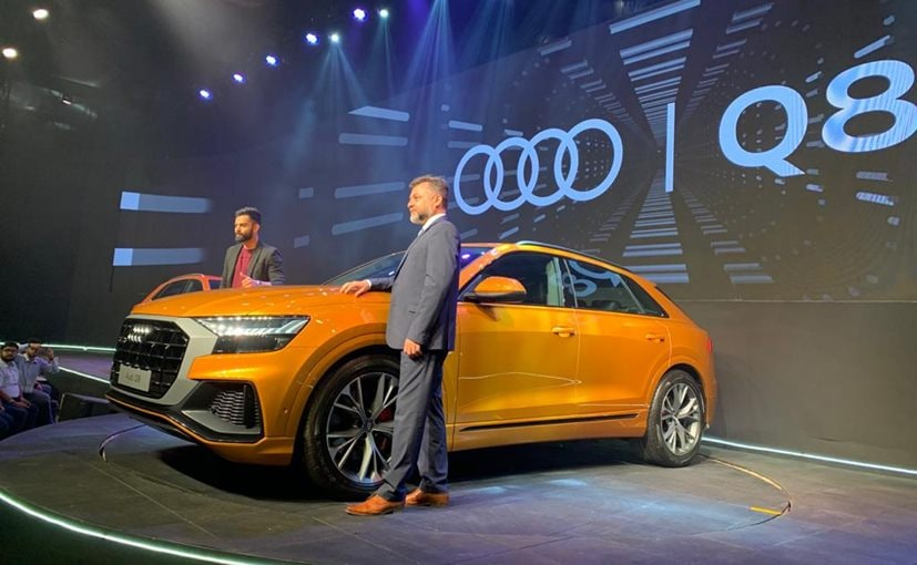 Cricketer Virat Kohli and Balbir Singh Dhillon, Head Audi India at the launch of the Q8