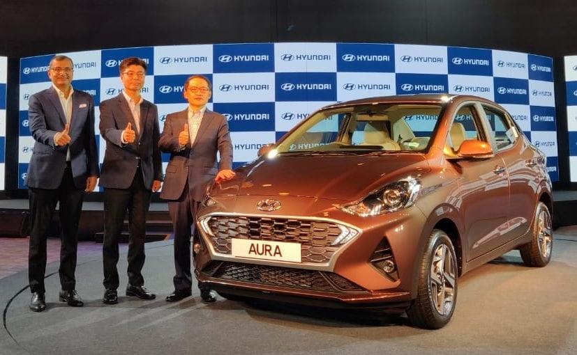 S S Kim, MD & CEO, Hyundai India and top managment with the new Hyundai Aura