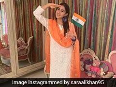 सारा अली खान ने किया सैल्यूट, तो वरुण धवन तिरंगा लेकर दौड़े- देखें बॉलीवुड गलियारे की फोटो और Video