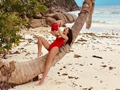 Amy Jackson Posts 'Real Life Vs Insta Life' Pics In <I>Baywatch</I> Swimsuit