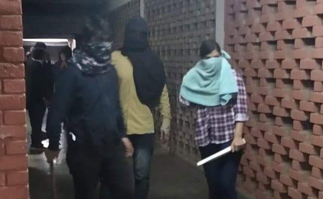 Image result for Masked Mob Attacks Students, Teachers At JNU, Several Injured