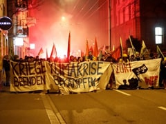 Switzerland Police Use Teargas, Water Cannons On Protesters