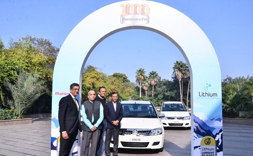 Pawan Goenka, MD & CEO, M&M, with Sanjay Krishnan, CEO Lithum, and managment team
