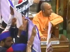 Chaos In UP Assembly, Opposition Leaders Carry Cylinders On Their Back