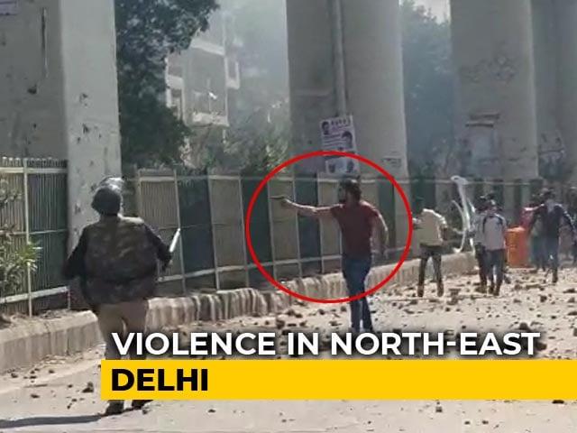 Video : On Camera,  Delhi Man Opens Fire As Cops Watch In Clashes Over CAA