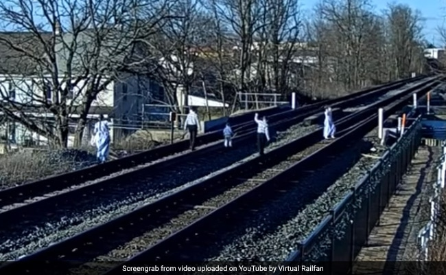 Narrow Escape For Family Taking Pics On Rail Tracks. Watch Scary Video