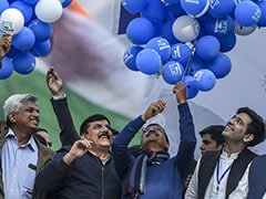 Party Workers Celebrate With Laddoos, Flowers, Balloons As AAP Sweeps Delhi Polls
