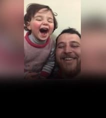Syrian Dad Teaches Girl To Laugh At Explosions In Heart-Breaking Video