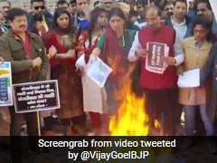 """""""Bundle Of Lies"""": BJP Leaders Burn Copies Of AAP Manifesto In Delhi"""