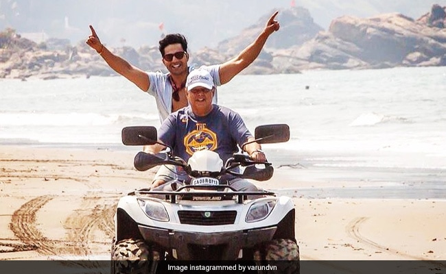 Varun Dhawan Chills With His 'Daddy Cool' David Dhawan On The Sets Of Coolie No 1