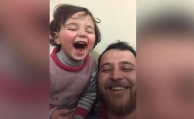 Watch: Syrian Man Helps Daughter Brave Sound Of Explosions With Laughter