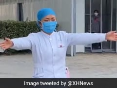 Watch: Nurse At China Coronavirus Hospital Gives Crying Daughter An 'Air Hug'
