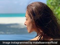 मलाइका अरोड़ा ने शेयर की पूल Photo, तो फैशन डिजाइनर बोले- अरे, आगे देखो पानी में गिर जाओगी...