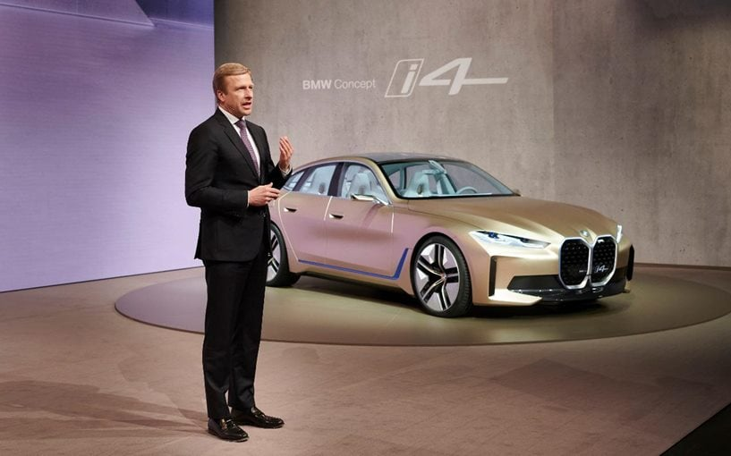 Oliver Zipse, Chairman of the Board of Management of BMW AG with the BMW i4 behind him