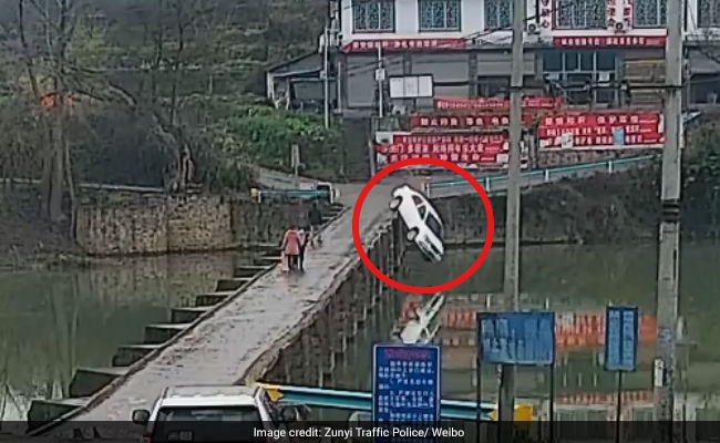 Busy On Phone, Driver Crashes Into River 10 Minutes After Getting License