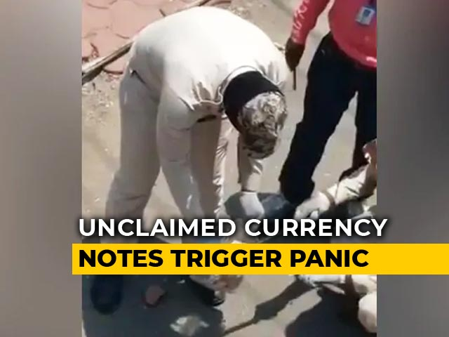 Video : Watch: Currency Notes Found On Roads In Madhya Pradesh Amid Lockdown, No Takers