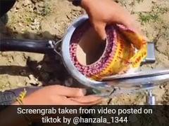 TikTok Viral Video: शख्स ने कुकर में डाल दी पटाखे की लड़ी, ढक्कन बंद कर लगाई आग, तो हुआ ऐसा...