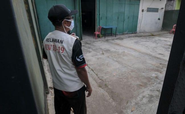 Indonesia Locks Up Coronavirus Quarantine Violators In 'Haunted House'