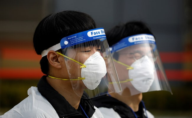 Work Smart, Travel Alone, Eat Out Fast: South Korea's 2-Year Virus Plan