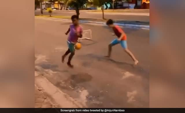 Kid scoring a goal while-playing-football, the player in front is also surprised, see viral video