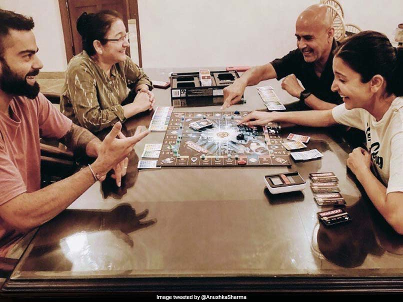 Anushka Shares Adorable Photo With Virat And Family Playing Monopoly