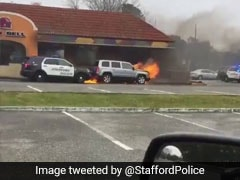 Quick-Thinking Cop Pushes Burning Car Away From Restaurant. Watch