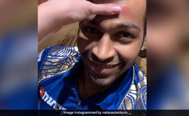 Hardik Pandya  fiance natasa stankovic puts lipstick on his head watch viral video