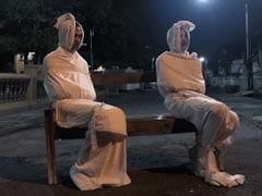 """""""Ghosts"""" Patrol Streets To Keep Indonesians Indoors And Away From Coronavirus"""