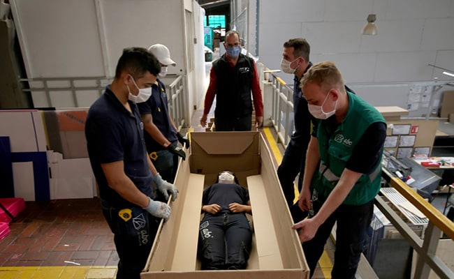 A Bed That Converts Into Coffin As Coronavirus Body Count Rises
