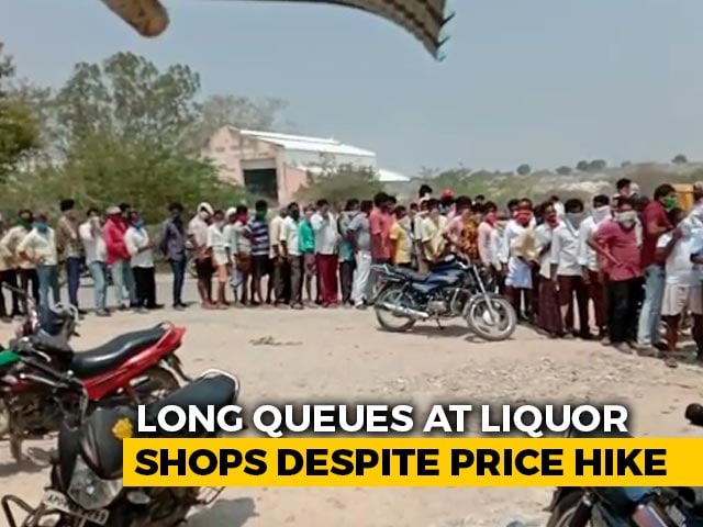 Video : Watch: Long Queues Outside Liquor Shops In Andhra Despite 25% Price Hike