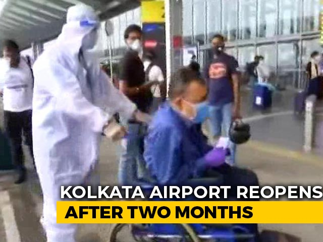 Video : Airline Staff In Protective Gear Wheel Out Passengers At Kolkata Airport