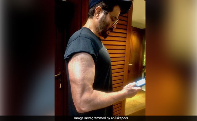 What Do You Think Anil Kapoor Is Doing In This Pic - 'Texting Or Flexing?'