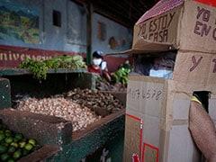 Cuban Woman, 82, Wears Cardboard Box To Shield Herself From Coronavirus