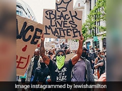"""Lewis Hamilton Marches In """"Really Moving"""" London Anti-Racism Protest"""