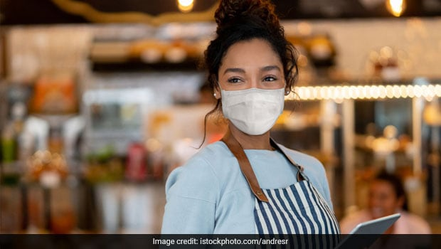 Watch: Brussels Restaurant Staff Wear Printed Masks To Serve Guests With A Smile