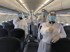 """Keep Middle Seats Empty Or Give """"Wrap-Around Gowns"""", Airlines Told"""