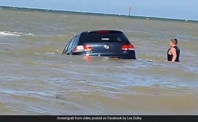 Dramatic Footage Shows Owner Trying To Save Car Swept Away By Sea