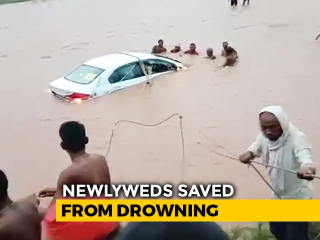Video : Watch: Locals Jump Into River To Save Newlywed Couple In A Half-Sunk Car